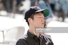 ストックフォト : Young man listening to the music