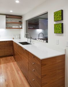 Modern Kitchen Design/build By Vanillawood. Grain Matched Walnut Cabinetry.  White Countertops +
