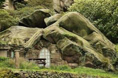 The Rock Cottage embedded in a sandstone cliff is located on five acres of woodlands and gardens in Wolverley, Worcestershire, England. It w...