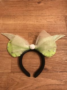 Custom Mickey Ears Made for Your Favorite Character! Perfect for a trip to Disneyland or Disney World and a chance for you to stand out.  Tinkerbell ears are made starting with a comfortable one size fits most headband covered in fleece that will stay on your head and will stay comfortable your entire adventure through Disney. The 4 in diameter ears are sewn securely to the headband and are solidified by a wire frame to keep them in tip top shape for years and years to come. The bows and…