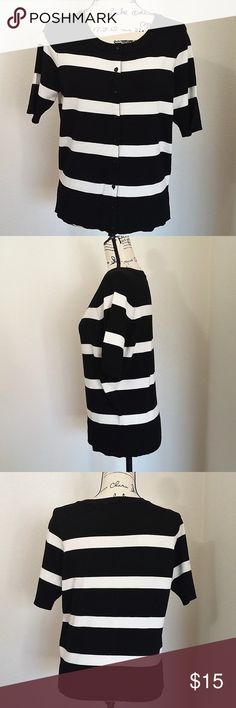 "size Large black/white striped button up sweater Black and white striped short sleeve sweater. Button front. Boat neck. Rayon/Nylon blend.   Size Large - 18"" pit to pit, 23"" length.  See photos for details. Smoke free, pet friendly home.   Please message me with any questions. Ask if additional size detail is needed.   15% discount for 3+ item bundles. Check out my closet. Happy Poshing!  668/CH Sweaters Crew & Scoop Necks"
