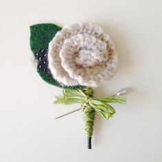 Everything is Rosy Boutonniere (With Feather) on Etsy, $12.00