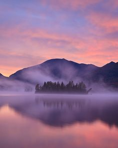 Photo of the Day: A lake nestled next to a mountain range. Mist and beautiful light add up to make a quintessential Adirondack sunrise. Photo by: Chris Tennant (Williamsburg, Virginia); North Hudson, New York
