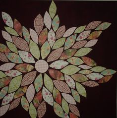 Pinterest inspired project! Cut out flower petals from scrapbooking paper and glued to a painted canvas! Fun and easy!