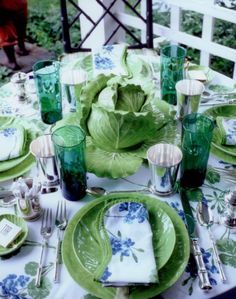Gorgeous place setting by Todd Romano,Porthault linens in blue and green, just exquisite.