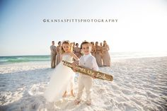"""Great """"Here Comes the Bride"""" sign idea for a beach wedding! Photo by Kansas Studios"""