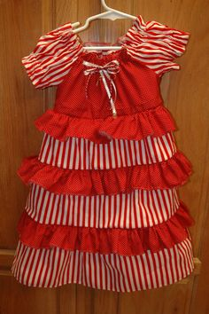 """Just in time for Christmas the """"Candy Cane Dress"""" Size 2 one available. baby/toddler dresses found at Etsy.com  shop childresscreations1. sizes from small 13-18lbs to size 8. Don't see what size you need? just ask. We will try and accomodate you."""