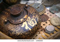 Vintage Chinese Teapot And Coins. The Golden Chinese Word On The ...
