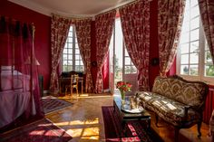 Red Chateau Bed Room Design with stunning Toile de Joue curtains and golden four-poster bed www.chateaurobertfrance.fr