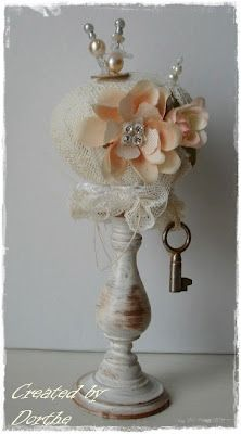 gorgeous pincushion - look at all the details - the pretty pins,flowers and the key.