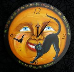 "halloween moon clock -- would love to try something similar on an old thrift store ""find"""