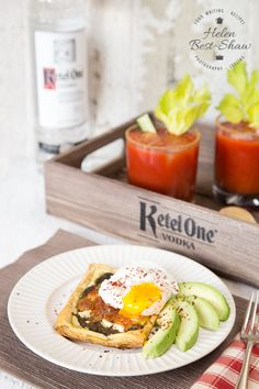 A perfect brunch - simple pesto and feta pastries with poached egg and avocado, served with a classic Bloody Mary