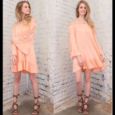 Off Shoulder Peach mini with Lace Detailing Beautiful Boho Chic style Mini dress in Peach. Dress has lace detail on the sleeves and elastic band around shoulder area. Contemporary style with loose fit. April Spirit Dresses Mini