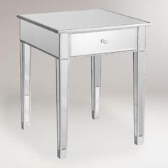 A reflection of modern design, our Mirrored Accent Table brings unparalleled glamour and sophistication to your home for a fraction of boutique store prices. Drawer featuring a faux crystal knob offers handy storage for living room items, and gleaming top is the ideal surface for a lovely bedside lamp.