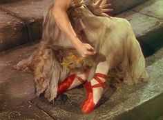The Red Shoes by Hans Christian Anderson... Poor Daddy had to read this story to me at bedtime every night -- for YEARS!
