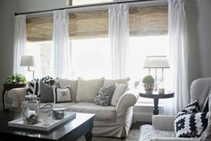 Blinds.com Gallery - Design-savvy blogger Shelley of Crazy Wonderful chose bamboo blinds to give much needed privacy to her living room. She added blackout liners to the bedroom shades for sound sleeping.