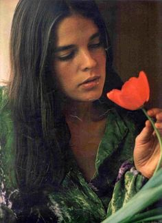 Ali MacGraw.  My style icon and idol.  Such personal style.  I love that she refused to have her crooked teeth fixed for her modeling career!  -LWL