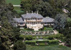 """#oprahwinfrey Montecito, Calif. Net Worth: $2.4 billion Rank: 400 The self-made media mogul paid $50 million in 2001 for the 23,000-square-foot Georgian-style home she calls the """"Promised Land."""" Although renovations were underway when she purchased the estate, Oprah simply altered the plans to ensure they matched her style. With the chaos of construction behind her, she now enjoys the home's mountain and ocean views in peace. #celebrityhomes"""