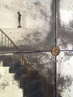Distressed mirrors with aged brass rosettes...Matthew Collins