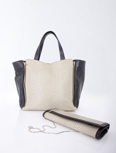 Bicoloured bag decorated with zips