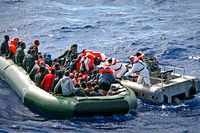 Irregular migrants adrift south of Malta are rescued by Armed Forces of Malta personnel, 2012 © EPA/LINO ARRIGO AZZOPARD