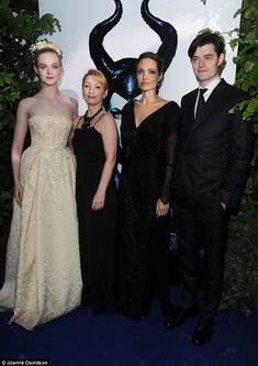 Say cheese: Elle Fanning, Lesley Manvillle, Angelina Jolie and Sam Riley all pose for a photo