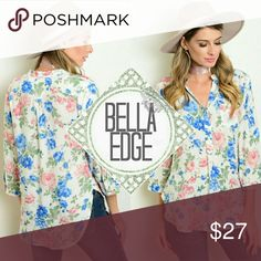 Bright floral button down tunic top 💎100% RAYON 💎This beautiful and delicate top features 3/4 sleeve, a gorgeous and vibrant floral print in hues of blue link and green all in a tunic style hemline you've come to love. Looks great with leggings or jeans and booties. 💎Size small to large Bella Edge Boutique Tops Tunics