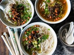 Simple broth, chewy rice noodles, meaty pork, and pungent pickled greens—perhaps the perfect soup.