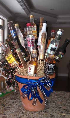Men don't care for flowers so...  make a bouquet of cigars and liquor...