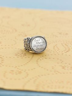 """The """"Fine Print"""" ring has an old-fashioned-letterpress look and is Sterling Silver ~ Item Number: R2821"""