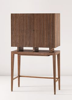 Gio Ponti, Illuminated cocktail cabinet, ca. 1940. Cerused oak, painted oak, brass, glass. Manufactured by Fontana Arte, Italy.