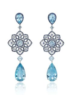 Chopard earrings with four pear-shaped aqumarines (29cts), six brilliant cut aquamarines (3.3cts) and sapphires