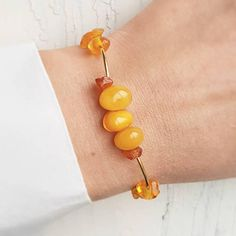 This natural amber bracelet made from vintage amber beads (no any treated). Every beads such as a little sun drop - very unique and vivid) Each bead made from whole amber stone -not pressed, not modified, not heated or another treatmented! Natural vintage baltic amber! You can see more beautiful gemstones jewelry here http://etsy.me/2s0Q6Vp Gemstone it's a gift of our planete and has very, very amazing and tremendous energetic and power! Just imagine -some gemstone was grown...