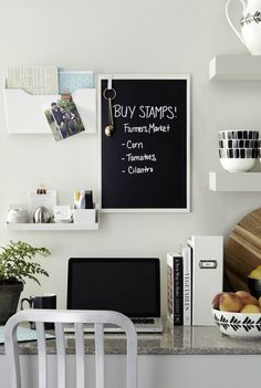 Don't have a dedicated office space at home? Set up a space-saving solution in the kitchen (or anywhere that has underutilized space!) with Martha's new Wall Manager System at Staples. Hang a dry erase board for writing notes to the family and add accessories like a file folder holder to store mail and a shelf to keep pens within easy reach.