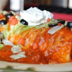"""Fabulous Wet Burritos   """"We made these exactly per the recipe. They were better than our local Mexican-style restaurant. They make great leftovers since you make the burritos as you go. The only change I would make would be to put the cheese inside of the burrito, since it slips off with all of the sauce. Thanks for the recipe!"""""""