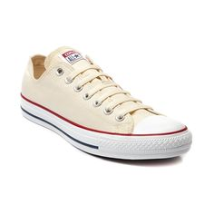 Shop for Converse All Star Lo Sneaker in Cream at Journeys Shoes. Shop today for the hottest brands in mens shoes and womens shoes at Journeys.com.The All Star knows no bounds. From b-ball courts to punk clubs. From skateparks to school yards. The Converse All Star has come a long way, and its ready to take you even further. The original Old School never lets up. Natural, cream canvas upper--red and navy accents.Please note that this shoe runs a half size large.