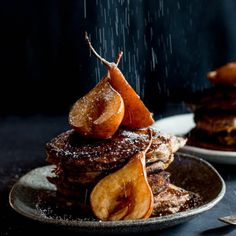 Warmly spiced sticky date pancakes with rich butterscotch sauce and caramelized pears. Dessert for breakfast!