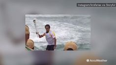 Aug 5, 2016; 9:23 AM ET This video shows the Olympic torch being carried by a surfer on Macumba Beach, in Rio de Janeiro, Brazil as the Summer Olympics kick off August 5. Warm and dry weather will make for ideal conditions.