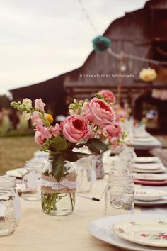 50flowers.com for centerpiece arrangements... hum I am thinking this is a great idea! Mason jars tied with ribbon and filled with a few stems.