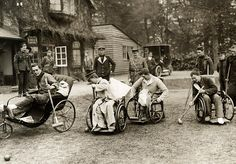 Wounded soldiers playing croquet in wheel chairs. England, 1915.