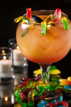 Witches Brew #3...•2.25 oz Caliche Rum   •2.25 oz Dark Rum   •1.25 oz Bacardi 151   •2.5 oz Pineapple Juice   •0.75 oz Lime Juice   •0.75 oz Simple Syrup   •1.25 oz Grenadine   •A multitude of Gummy Worms!   •As many silly straws as desired
