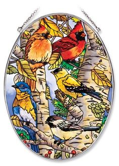 Amia 6433 Large Oval Suncatcher with Songbird Design, 6-1/2-Inch W by 9-Inch L, Hand-painted Glass by Amia. $22.00. Includes chain. Hand-painted glass. 6-1/2-inch w by 9-inch l. Enjoy this Amia large oval suncatcher with a beautiful songbird design.  Comes boxed, perfect gift for someone special.