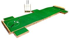 LUXURY GIFT Customizable Indoor Putting Green  This custom-made, two-cup indoor putting green is the ultimate accoutrement for any golf lover.