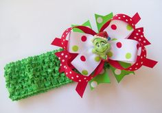 If she loves the Grinch she will adore this Green Grin Santa Boutique Hair Bow And Headband.  Bow can be worn alone or attached to the headband for two great looks... $6.50