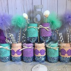 This is what three sets of my mermaid mason jars look like! The perfect centerpiece for that mermaid party.