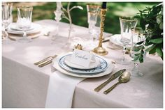 Classic place setting of blue and white china, gold-rimmed crystal, gold flatware and calligraphy place card. Styling and florals by Stephanie Gibbs Events, linen from Nuage Designs, rentals from EventHaus, calligraphy place cards by Penned by Palmer. Image by Jennings King Photography.