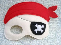 This felt pirate mask is sure to be a hit in the dress up box! Its made from soft eco felt with elastic. It has an eye patch applique and