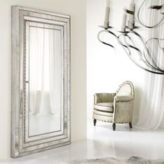 Love this elegant floor mirror for an entry