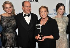 The royal couple stand alongside Julie Andrews and Anne Hathaway at the glamorous awards gala.