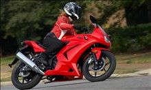 A small and nimble sport motorcycle such as Kawasaki Ninja 250r can make an excellent first bike and full riding gear is the only safe way to go from the very start.
